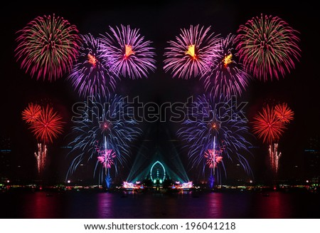 Beautiful firework display on the river, city night - stock photo