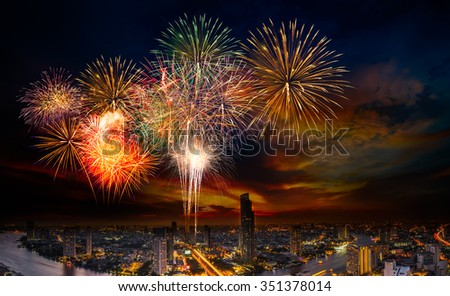 Beautiful firework in festival event exploding over the cityscape - stock photo