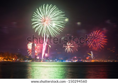 beautiful fireworks celebrating new year on patong beach thailand - stock photo