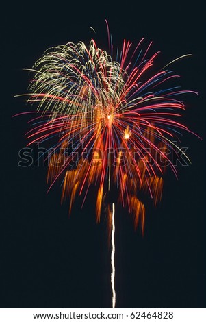 Beautiful fireworks display fills the night time sky - stock photo
