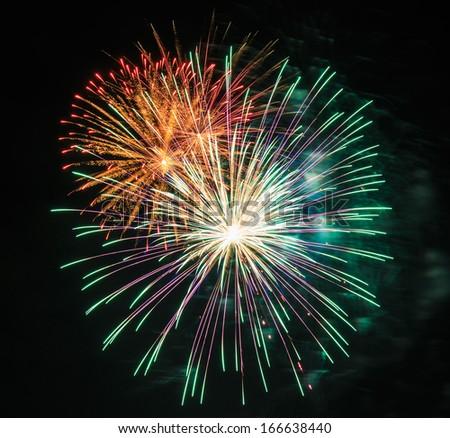 Beautiful fireworks in celebration - stock photo