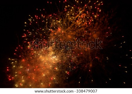 Beautiful fireworks in the night sky, motion blur, for abstract background