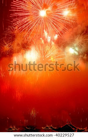 beautiful fireworks with red sky - stock photo