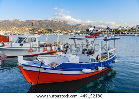 Beautiful fishing boat staing parked at harbour of Sitia town on Crete island, Greece - stock photo