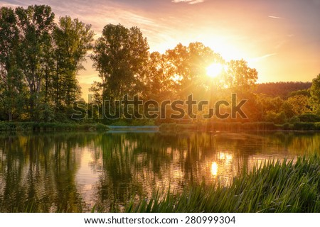 Beautiful fishing lake in sunrise / This image was created with a HDR (high dynamic range) technology - stock photo