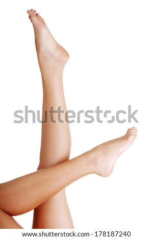 Beautiful fit long female legs, isolated on white - stock photo