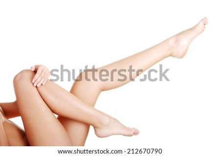 Beautiful fit long female legs, isolated on white