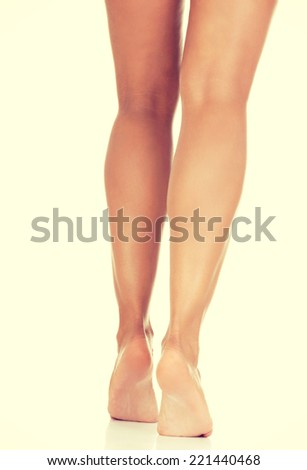 Beautiful fit long woman legs - stock photo