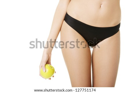 Beautiful fit sensual female body and apple isolated on white background