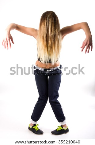 beautiful fit woman dancing in a tracksuit - stock photo