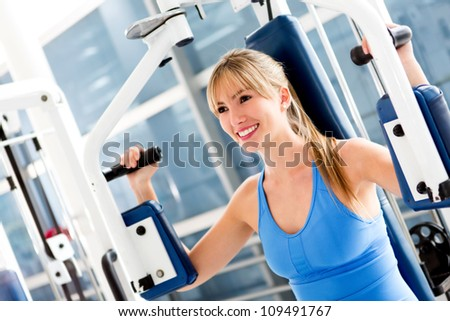 Beautiful fit woman exercising at the gym