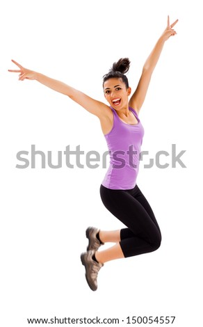 Beautiful fit young lady jumping enjoying her healthy life.