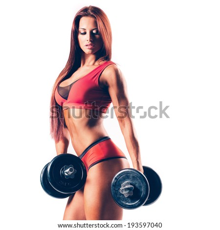 beautiful fitness female posing on studio background - stock photo