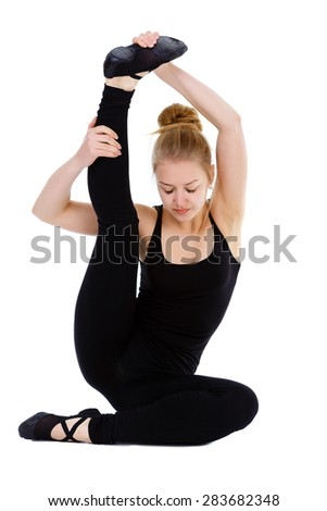 Beautiful fitness flexible woman gymnast doing stretching exercise holding one leg above, isolated on white background - stock photo