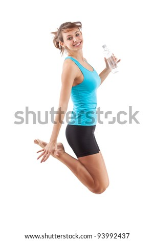 Beautiful fitness girl jumping isolated on white background