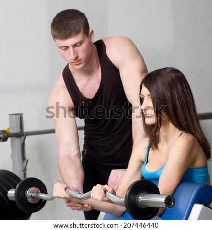 Beautiful fitness woman and muscular sports man in gymnasium  - stock photo