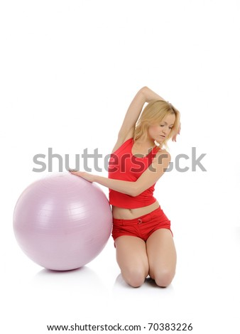 Beautiful fitness woman doing exercise with pilates ball. isolated over white