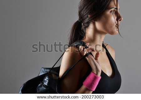 beautiful fitness woman with a gym bag, close up, studio shot