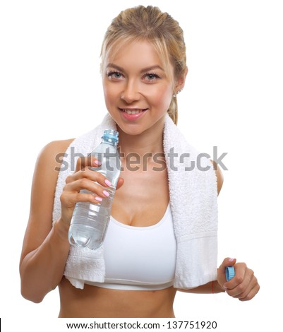 Beautiful fitness woman with bottle of water and towel. Sport. Isolated on white background. - stock photo