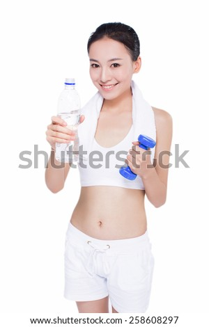 beautiful fitness woman with bottle of water and towel. sport. white background.