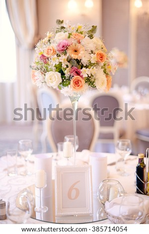 Beautiful floral bouquet on a white wedding table  - stock photo