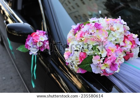 Beautiful floral decoration is on a wedding car - stock photo