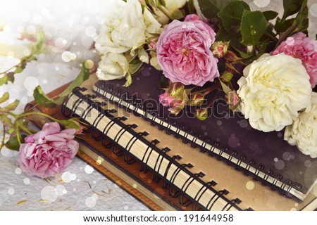 Beautiful flower background with roses and handmade paper, Rose bouquet, wedding card, spring flowers - stock photo