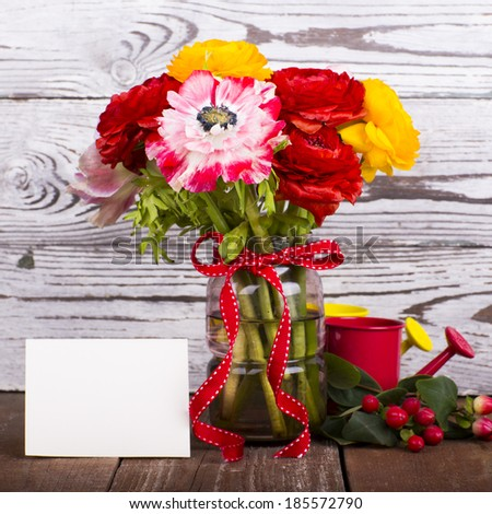 Beautiful flower bouquet on wooden table - stock photo
