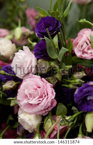 Beautiful flower composition with lisianthuses or roses - stock photo