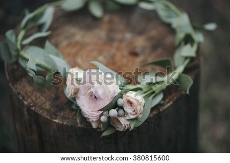 Beautiful flower headband on a rustic wooden stump - stock photo