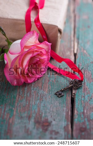 Beautiful flower rose on vintage dark  wooden background.  Selective focus.