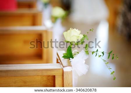 Beautiful flower wedding decoration in a church during catholic wedding ceremony  - stock photo