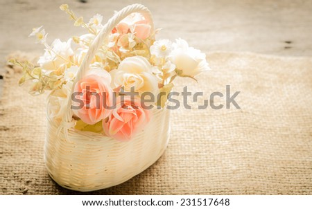 Beautiful flowers in a basket, vintage style. - stock photo