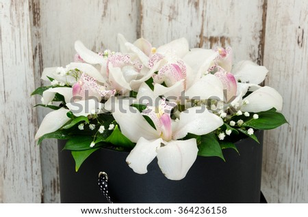 Beautiful flowers in a gift box - stock photo