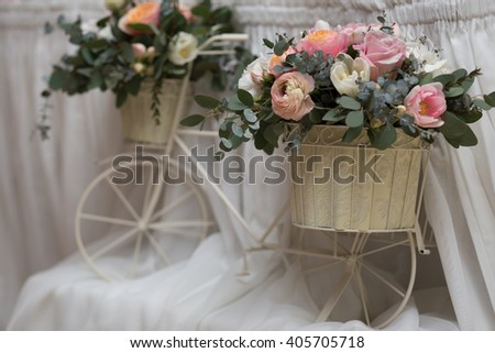 Beautiful flowers in pots on decorative bicycle