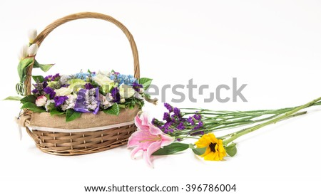 Beautiful flowers in the basket isolated on white background