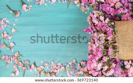 Beautiful flowers on green wood. - stock photo