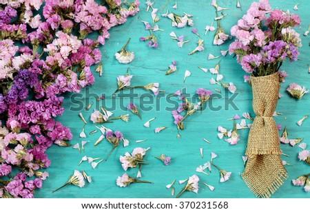 Beautiful flowers on green wood. - stock photo
