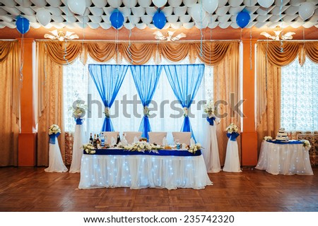Beautiful flowers on table in wedding day. Table decor with flowers table numbers and candles.  - stock photo