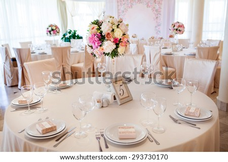 Beautiful flowers on table in wedding day. Wedding table set.   - stock photo