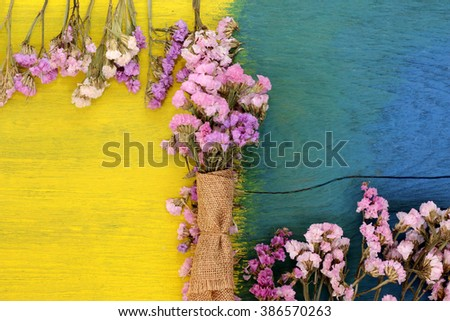 Beautiful flowers on the wooden floor, yellow and blue.