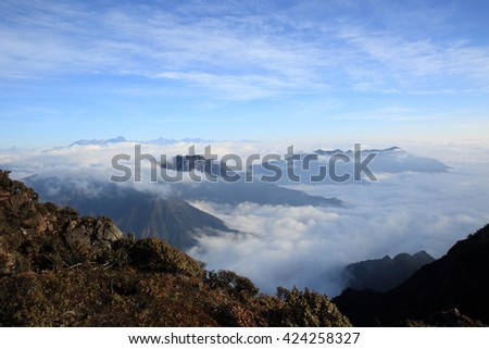 beautiful fog among frozen mountain summits landscape