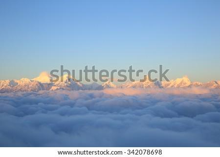 beautiful fog among sunrise  frozen mountain summits landscape - stock photo
