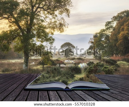 Beautiful foggy misty Fall sunrise over countryside surrounding Crummock Water in Lake District in England coming out of pages of book