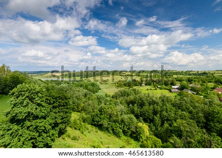 Beautiful forest landscape with blue sky, a typical Russian nature, Stary Izborsk village, Russia.