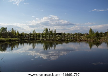 Beautiful forest pond in early spring in Central Russia.
