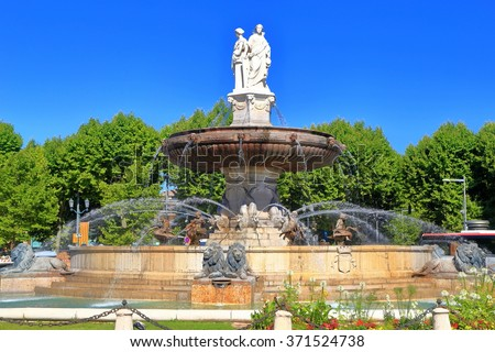 Beautiful fountain in sunny square surrounded by trees, Aix en Provence, Languedoc Roussillon, France - stock photo