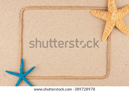 Beautiful frame of rope  and starfish  on the sand, with place for your image, text, as background - stock photo