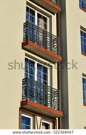 Beautiful French balconies on the wall of the new House