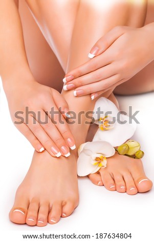 beautiful french manicure and pedicure  with white orchidand - stock photo